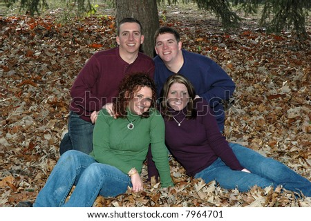 brothers and sisters in leaves - stock photo
