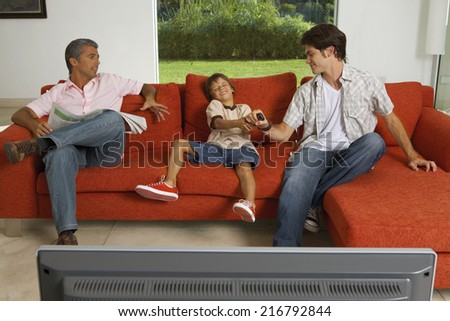 Brothers fighting for the TV remote. - stock photo