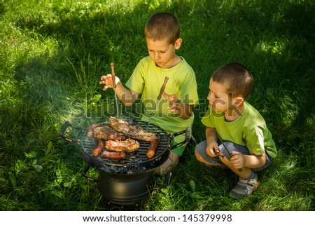 Brothers having a barbecue party - stock photo