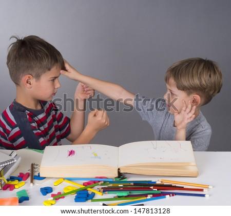 brothers in a quarrel during learning - stock photo