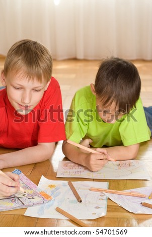 brothers lying on the floor and draw