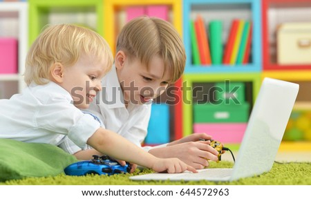 Brothers playing a computer game