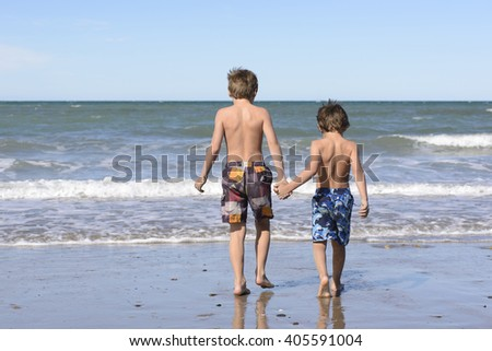 Brothers Playing in the Sea