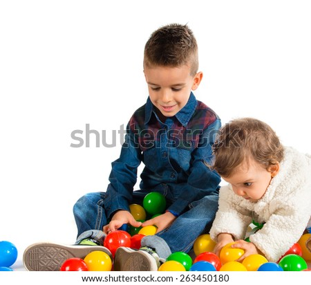 Brothers playing with colored balls