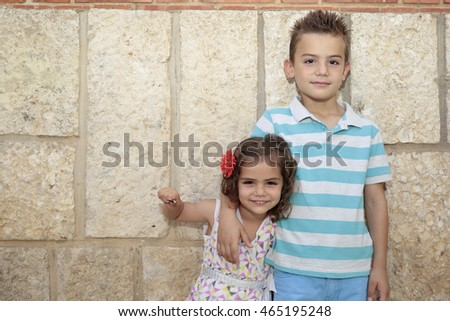 brothers portrait of two children with a bottom wall