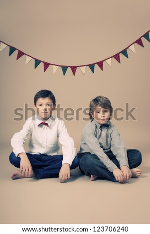 Brothers with bow tie during Christmas - stock photo