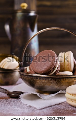 Brown and beige macaroon on a wooden background. Selective focus.