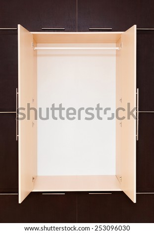 Brown and beige. modern wooden wardrobe. closed.