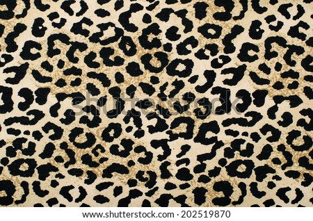 Brown and black leopard pattern. Animal print as background.