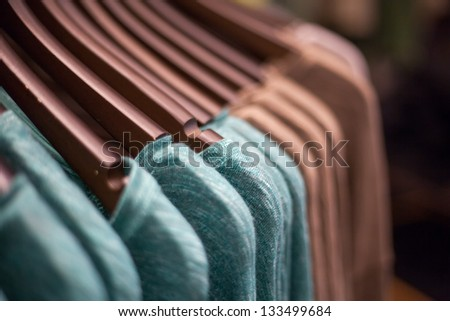 Brown and green Shirts hanging in Line on hanger. - stock photo