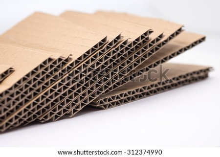 Brown and waste cardboard or recycle paper on white background  - stock photo