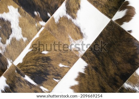 Brown and white animal fur blanket, fur - stock photo