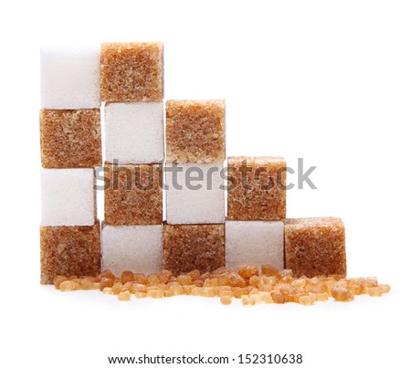 Brown and white cane sugar cubes isolated. - stock photo
