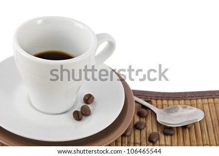 brown and white coffee cups with coffee beans and spoon - stock photo