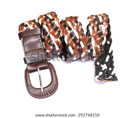 Brown and white leather belt on white background - stock photo