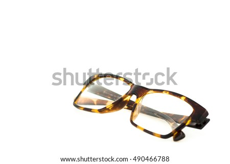 brown and yellow vintage plastic eyeglasses on white background