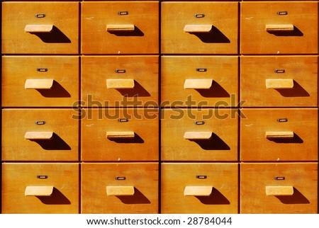 Brown antique wooden bureau drawers - stock photo