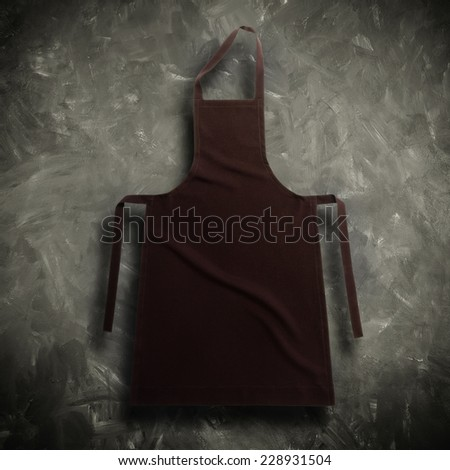 Brown apron against vintage background - stock photo