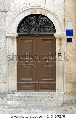 Brown arch door at medieval house