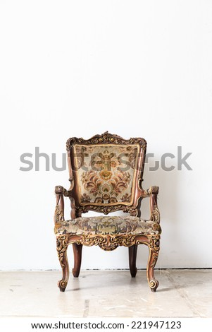 Brown armchair sofa on white wall.