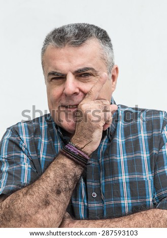 Brown attractive middle-aged man gesturing
