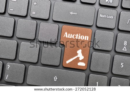 Brown auction key on keyboard - stock photo