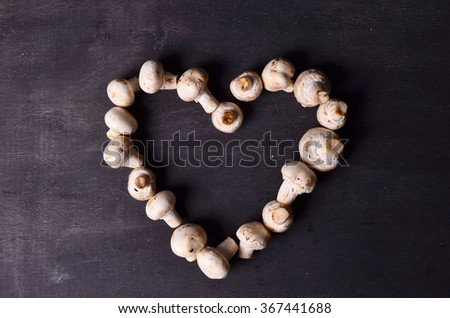 Brown beech mushrooms, Love. Heart by mushrooms - stock photo