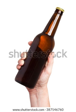 brown beer bottle in hand isolated on white background - stock photo