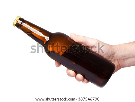 brown beer bottle in hand isolated on white background