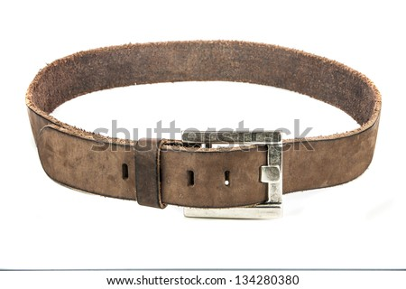 Brown belt with metal buckle isolated on white