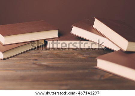 brown books lying on a wooden table, space for text, selective focus