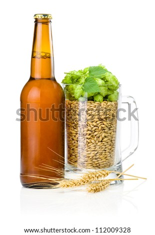 Brown bottle of beer, Mug full of barley and hops, Wheat ears isolated on white background - stock photo