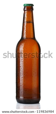 Brown bottle of beer with drops on white background