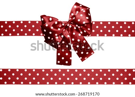 brown bow and ribbon with white polka dots made from silk isolated - stock photo