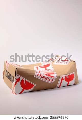 brown box with fragile sticker damaged - stock photo