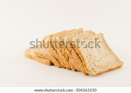 Brown bread slice isolated on white. - stock photo