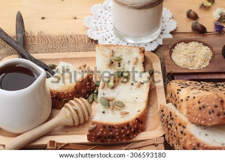 Brown bread with whole grain cereals of sliced and milk