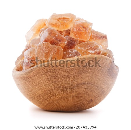 Brown cane caramelized lump sugar in wooden bowl isolated on white background cutout - stock photo
