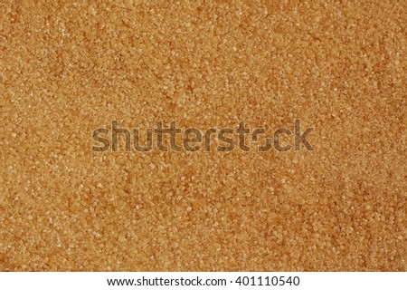 Brown cane sugar background,overhead horizontal view.Healthy dry raw brown cane unrefined sugar.
