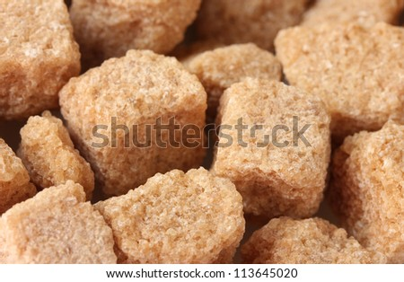 brown cane sugar cubes background close-up - stock photo