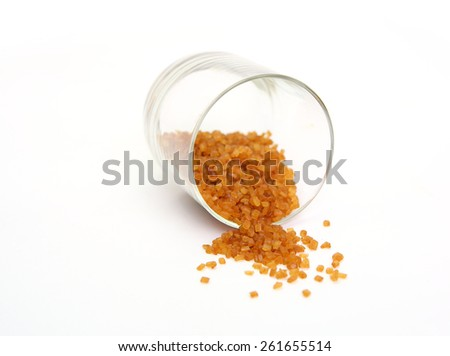 Brown caramelized sugar in a glass jar - stock photo