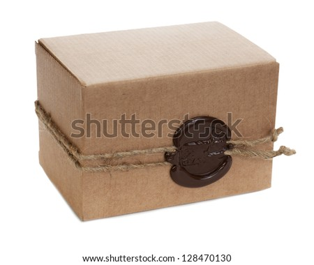 brown cardboard box with stamp isolated on white background - stock photo