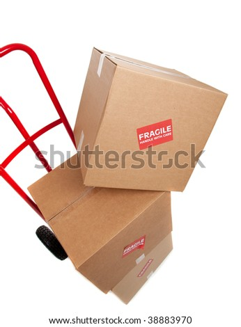 Brown cardboard moving box on a white background with a fragile sticker - stock photo