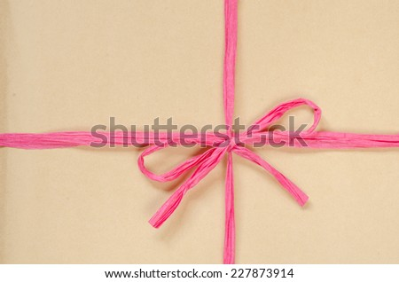 brown cardboard package background tied with twine - stock photo