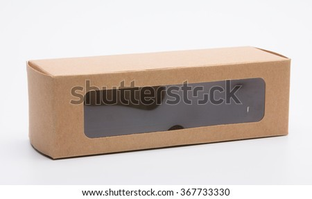 Brown cardboard package box with window covered PVC plastic - stock photo