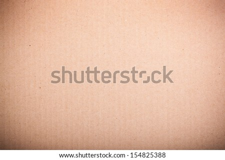 Brown cardboard texture. Can be used as grunge background.