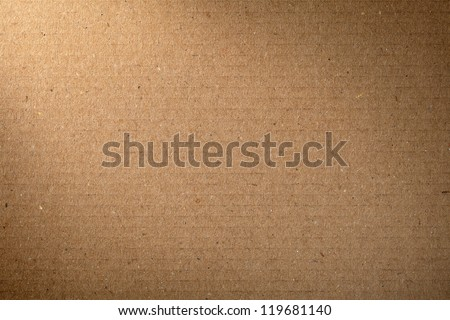 Brown cardboard texture for background, lighting from the left corner - stock photo
