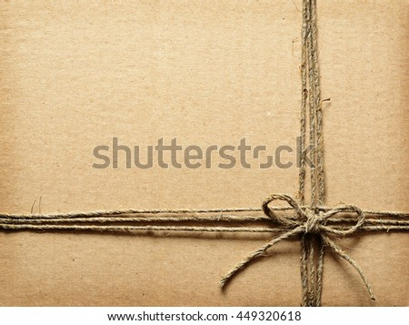 Brown cardboard tied with rope