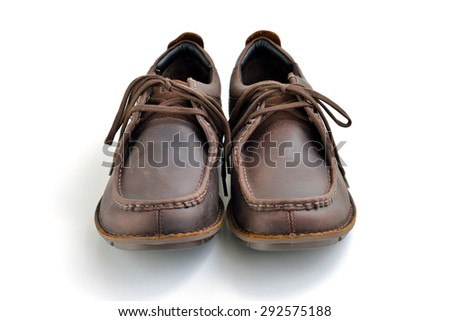 Brown casual leather man shoes isolated on white background, selective focus.