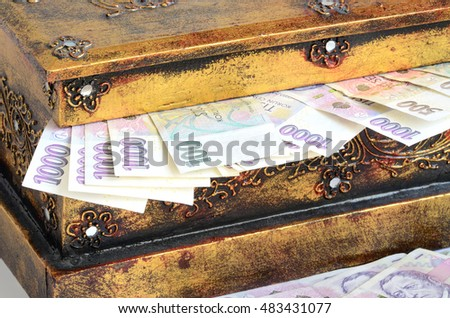 Brown chest full of czech banknotes money currency